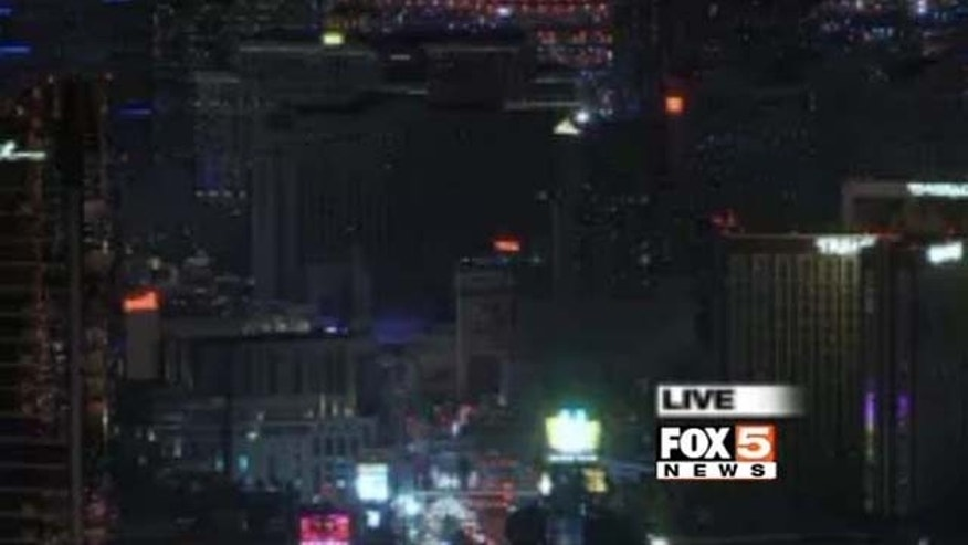 Feb. 18, 2015: This photo shows dimmed lights at major casinos along the Las Vegas Strip in tribute to late UNLV basketball coach Jerry Tarkanian, who died Feb. 11 at age 84. (Photo courtesy KVVU-TV)