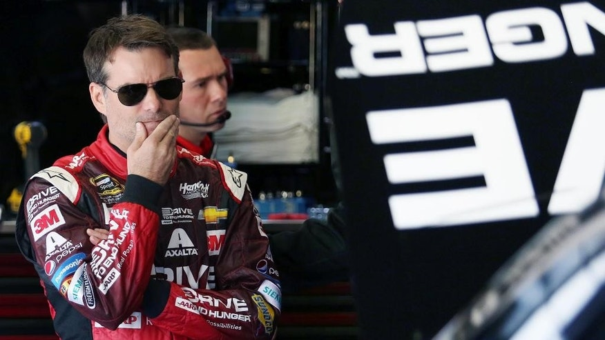 Jeff Gordon looks at his race car before Sprint Cup practice for the Daytona 500 at Daytona International Speedway in Daytona Beach, Fla. on Wednesday, Feb. 18, 2015. (AP Photo/Orlando Sentinel, Stephen M. Dowell) MAGS OUT; NO SALES