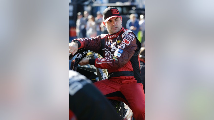 Jeff Gordon climbs out of his car after a practice session for the Daytona 500 NASCAR Sprint Cup Series auto race at Daytona International Speedway, Wednesday, Feb. 18, 2015, in Daytona Beach, Fla. (AP Photo/John Raoux)