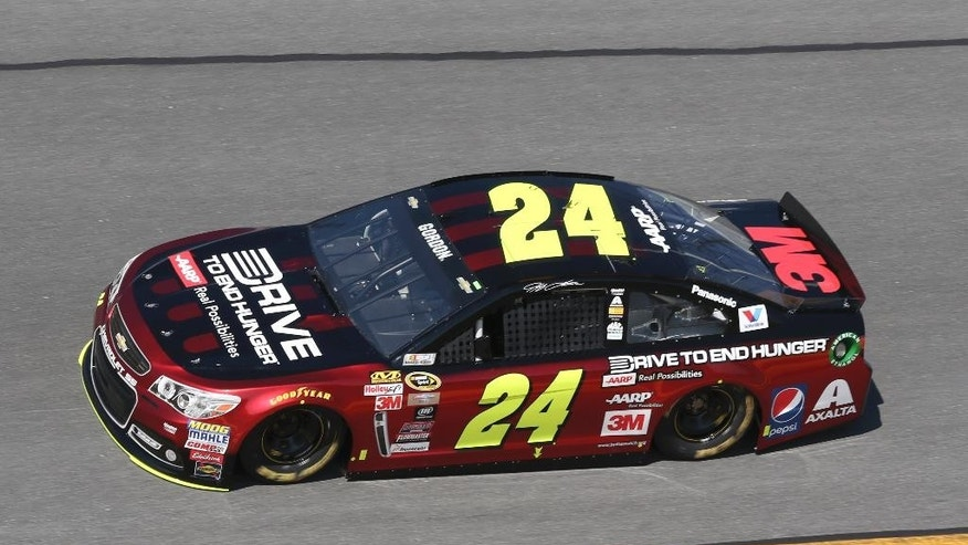 Jeff Gordon (24) earns the pole position while qualifying for the Daytona 500 NASCAR Sprint Cup Series auto race at Daytona International Speedway, Sunday, Feb. 15, 2015, in Daytona Beach, Fla. (AP Photo/Reinhold Matay)
