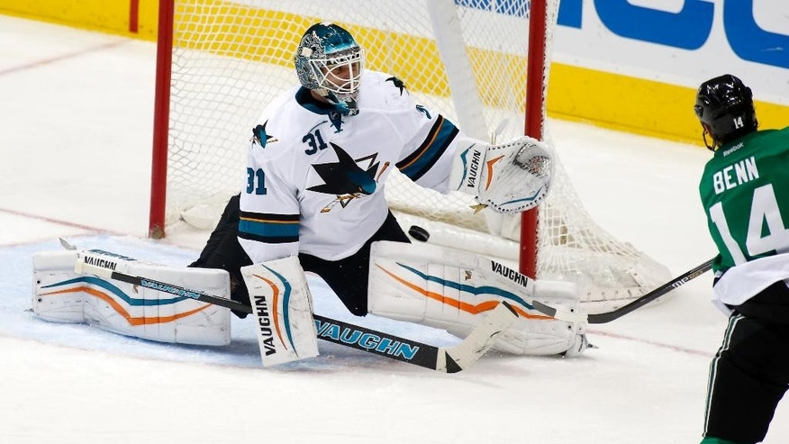 San Jose Sharks goals Antti Niemi (21), of FInland, makes a save on a shot by Dallas Stars left wing Jamie Benn (14) in the second period of an NHL hockey game Thursday, Feb. 19, 2015, in Dallas. (AP Photo/Sharon Ellman)