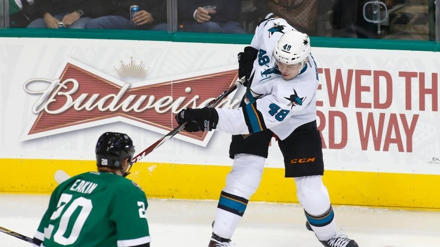 Dallas Stars center Cody Eakin defends as San Jose Sharks center Tomas Hertl (48),of the Czech Republic, scores a goal in the second period of an NHL hockey game Thursday, Feb. 19, 2015, in Dallas. (AP Photo/Sharon Ellman)