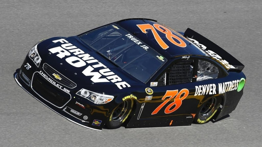 Martin Truex Jr. goes through turn 4 during a practice session for the Daytona 500 NASCAR Sprint Cup Series auto race at Daytona International Speedway, Saturday, Feb. 14, 2015, in Daytona Beach, Fla. (AP Photo/David Graham)