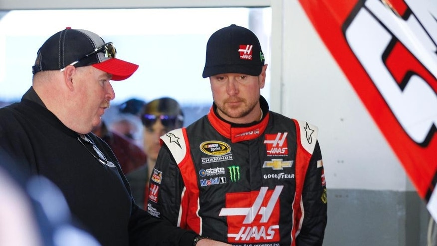 Kurt Busch, right, talks with his crew chief Tony Gibson, left, in his garage during a practice session for the Daytona 500 NASCAR Sprint Cup Series auto race at Daytona International Speedway, Wednesday, Feb. 18, 2015, in Daytona Beach, Fla. (AP Photo/Terry Renna)
