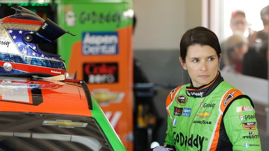 Danica Patrick gets ready in her garage before a practice session for the Daytona 500 NASCAR Sprint Cup Series auto race at Daytona International Speedway, Wednesday, Feb. 18, 2015, in Daytona Beach, Fla. (AP Photo/John Raoux)