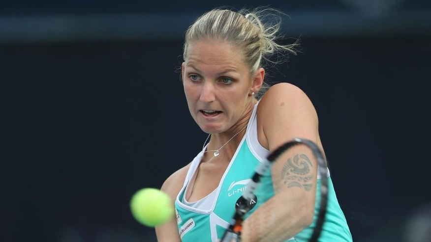 Karolina Pliskova of the Czech Republic returns the ball to Garbine Muguruza of Spain during a semi final match of the Dubai Duty Free Tennis Championships in Dubai, United Arab Emirates, Friday, Feb. 20, 2015. (AP Photo/Kamran Jebreili)