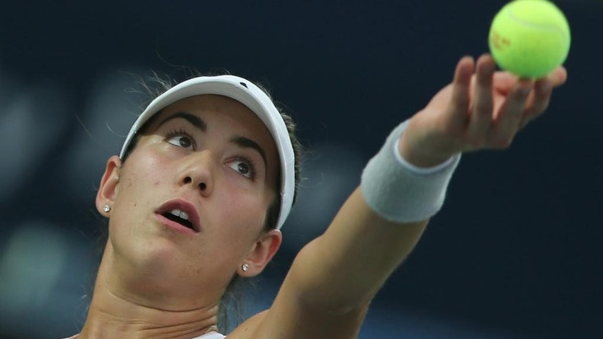Garbine Muguruza of Spain serves the ball to Karolina Pliskova of the Czech Republic during a semi final match of the Dubai Duty Free Tennis Championships in Dubai, United Arab Emirates, Friday, Feb. 20, 2015. (AP Photo/Kamran Jebreili)