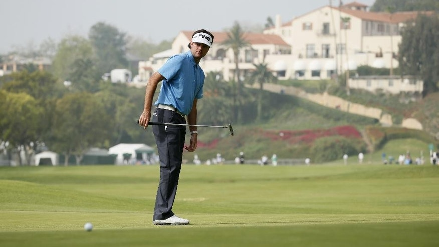Bubba Watson makes a long eagle putt on the first hole as the clubhouse is seen behind him during the second round of the Northern Trust Open golf tournament at Riviera Country Club in the Pacific Palisades area of Los Angeles on Friday, Feb. 20, 2015. (AP Photo/Danny Moloshok)
