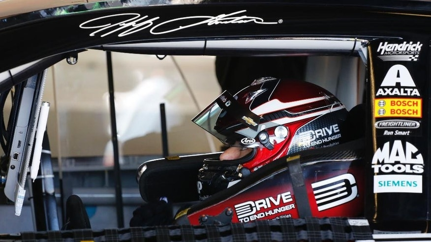 Jeff Gordon sits in his car during practice for the Daytona 500 NASCAR Sprint Cup series auto race at Daytona International Speedway in Daytona Beach, Fla., Friday, Feb. 20, 2015. (AP Photo/Terry Renna)