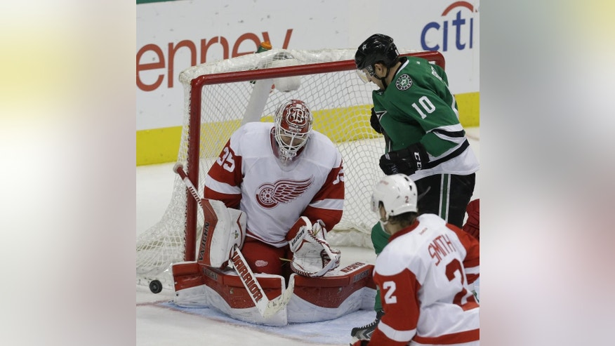 Detroit Red Wings goalie Jimmy Howard (35) blocks a shot against Dallas Stars center Shawn Horcoff (10) during the third period of an NHL hockey game Saturday, Feb. 21, 2015, in Dallas. The Red wings won 7-6 in overtime. (AP Photo/LM Otero)