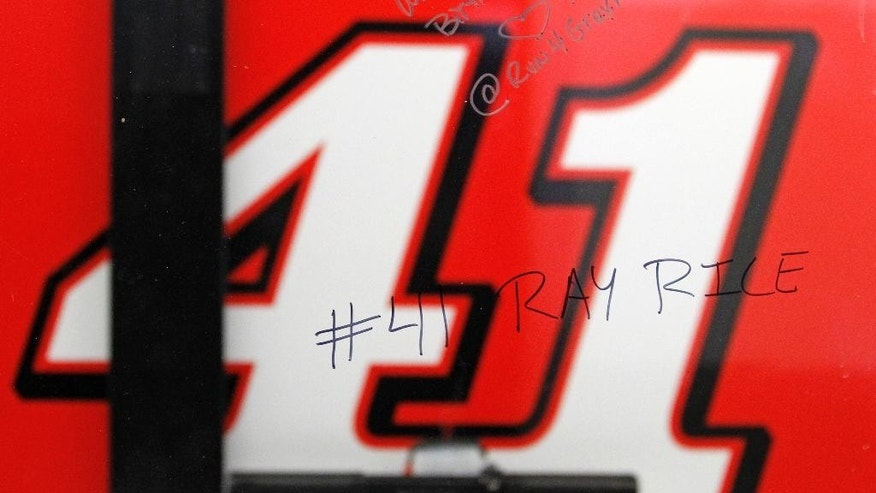 "A window outside driver Kurt Busch's garage stall shows a reference to NFL player Ray Rice written by a spectator at Daytona International Speedway in Daytona Beach, Fla., Friday, Feb. 20, 2015. In a stunning move just two days before the season-opening Daytona 500, NASCAR suspended Kurt Busch indefinitely on Friday after a judge said the former champion almost surely strangled and beat an ex-girlfriend last fall and there was a ""substantial likelihood"" of more domestic violence from him in the future. (AP Photo/Terry Renna)"