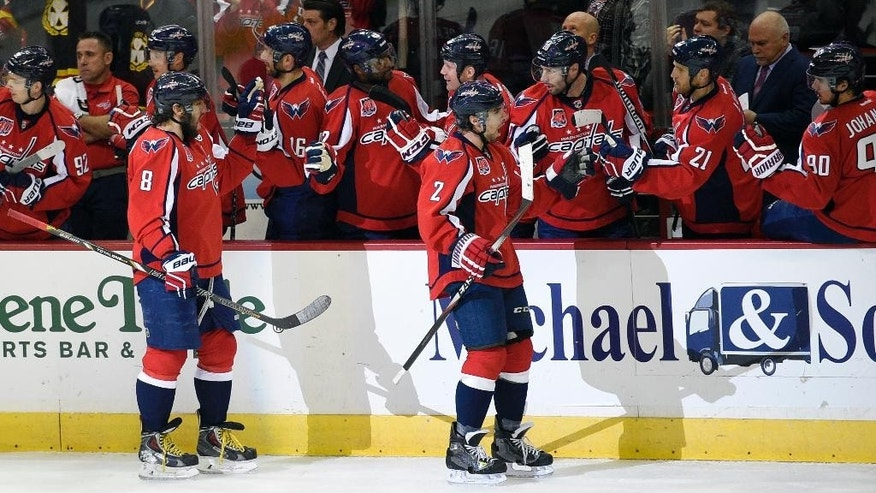 Washington Capitals defenseman Matt Niskanen (2) celebrates his goal with Brooks Laich (21), Marcus Johansson (90), of Sweden, and others during the first period of an NHL hockey game against the New York Islanders, Saturday, Feb. 21, 2015, in Washington. Also seen is Washington Capitals left wing Alex Ovechkin (8), of Russia. (AP Photo/Nick Wass)