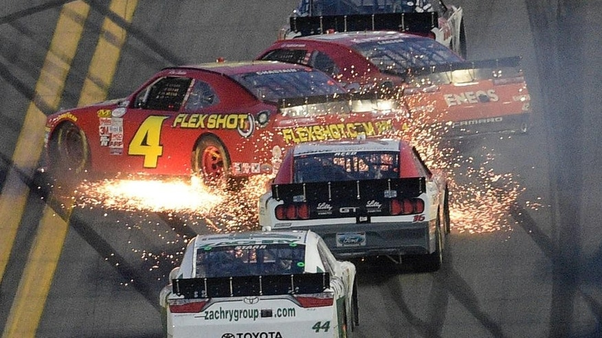 Ross Chastain (4) and Kyle Larson (42) collide during a NASCAR Xfinity series auto race at Daytona International Speedway, Saturday, Feb. 21, 2015, in Daytona Beach, Fla. (AP Photo/Phelan M. Ebenhack)