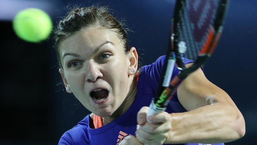 Simona Halep of Romania returns the ball to Karolina Pliskova of the Czech Republic during the final match of the Dubai Duty Free Tennis Championships in Dubai, United Arab Emirates, Saturday, Feb. 21, 2015. (AP Photo/Kamran Jebreili)