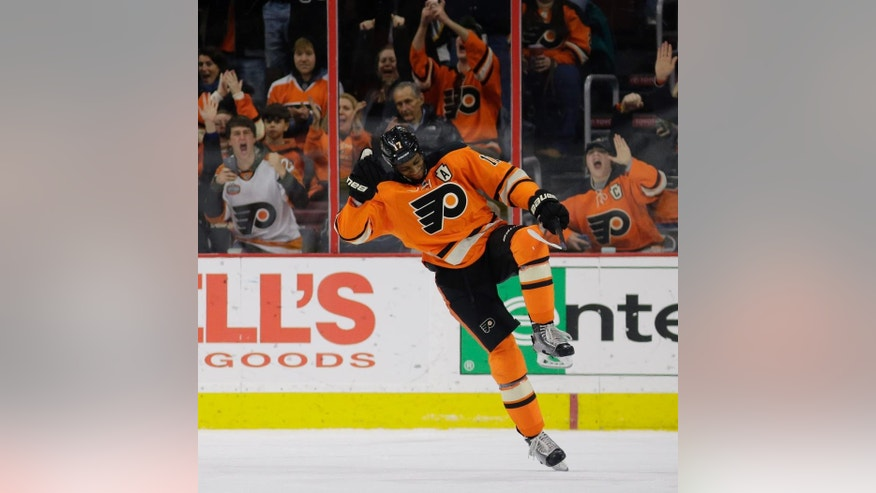 Philadelphia Flyers' Wayne Simmonds celebrates after scoring a goal during a shootout in an NHL hockey game against the Nashville Predators, Saturday, Feb. 21, 2015, in Philadelphia. Philadelphia won 3-2. (AP Photo/Matt Slocum)