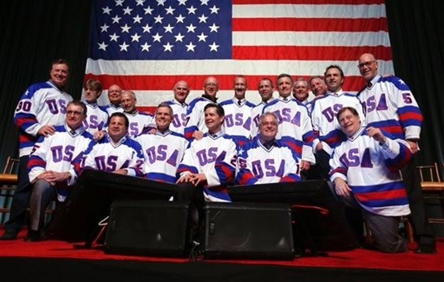 "Members of the 1980 U.S. ice hockey team pose for photos after a ""Relive the Miracle"" reunion at Herb Brooks Arena on Saturday, Feb. 21, 2015, in Lake Placid, N.Y.  Every surviving member of the hockey team returned to the hockey rink on Main Street they made famous with one of the most memorable upsets in sports history. (AP Photo/Mike Groll)"