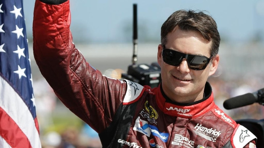Jeff Gordon gives a thumbs-up to the crowd as he in introduced before the Daytona 500 NASCAR Sprint Cup series auto race at Daytona International Speedway in Daytona Beach, Fla., Sunday, Feb. 22, 2015. (AP Photo/John Raoux)