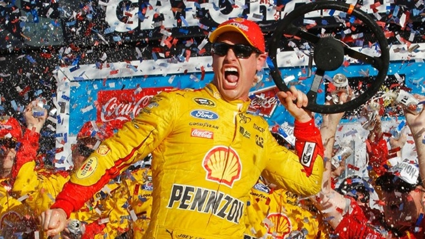 Feb. 22, 2015: Joey Logano celebrates in Victory Lane after winning the Daytona 500 NASCAR Sprint Cup series auto race at Daytona International Speedway in Daytona Beach, Fla.