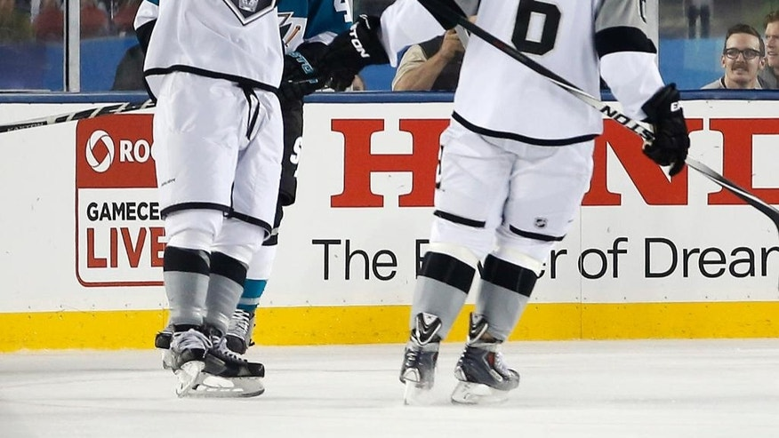 Los Angeles Kings' Kyle Clifford, left, celebrates his goal with teammate Jake Muzzin (6) against the San Jose Sharks during the first period of an NHL hockey game Saturday, Feb. 21, 2015, in Santa Clara, Calif. (AP Photo/Tony Avelar)