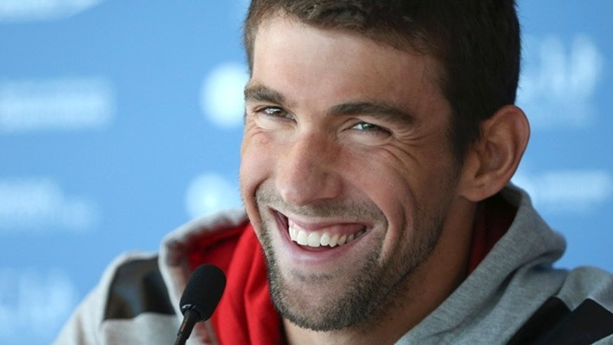 Aug. 20, 2014: File photo, U.S. swimmer Michael Phelps laughs during a news conference ahead of the Pan Pacific swimming championships in Gold Coast, Australia.