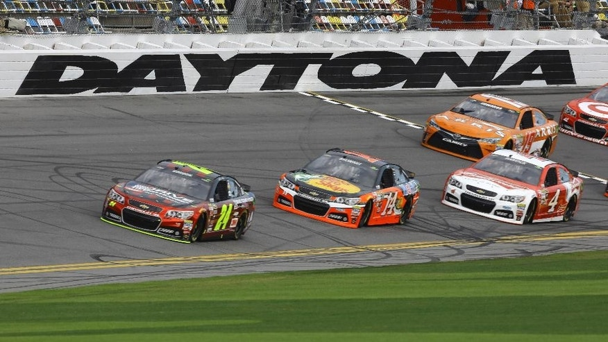 Jeff Gordon (24) leads Tony Stewart (14), Kevin Harvick (4), and Carl Edwards (19) during practice for the Daytona 500 NASCAR Sprint Cup series auto race at Daytona International Speedway in Daytona Beach, Fla., Saturday, Feb. 21, 2015. (AP Photo/David Graham)