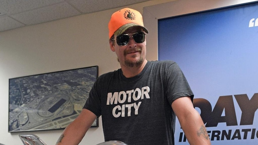Kid Rock poses with the winner's trophy during a news conference before the Daytona 500 NASCAR Sprint Cup series auto race at Daytona International Speedway in Daytona Beach, Fla., Sunday, Feb. 22, 2015. (AP Photo/Phelan M. Ebenhack)