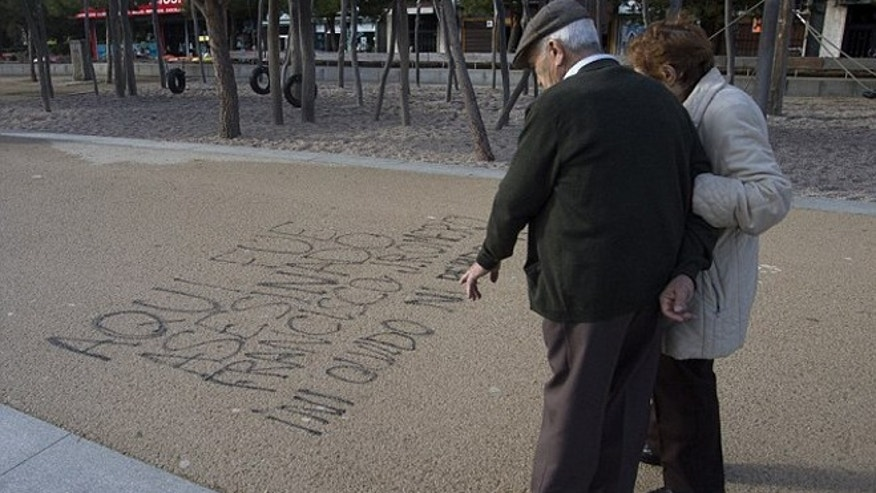 "Graffiti reading, ""Here Francisco Romero was killed. I don't forget; I don't forgive."" (Photo: AP)"
