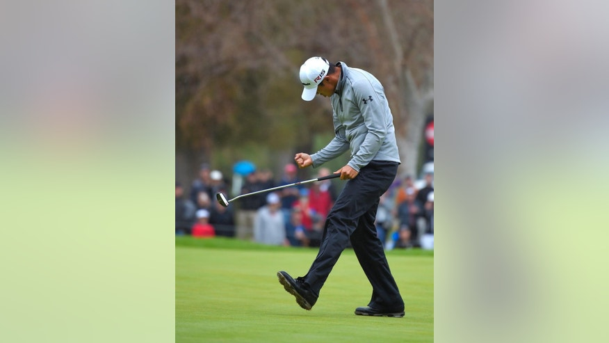 James Hahn celebrates the birdie putt that gave him a one-stroke victory on the 14th green, the third playoff hole, in the final round of the Northern Trust Open golf tournament at Riviera Country Club in the Pacific Palisades area of Los Angeles Sunday, Feb. 22, 2015.(AP Photo/Mark J. Terrill)