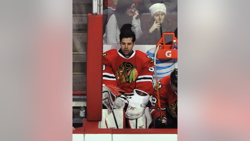 Chicago Blackhawks goalie Corey Crawford (50), sits on the bench after being pulled during the second period of an NHL hockey game against the Boston Bruins Sunday, Feb. 22, 2015 in Chicago. Boston won 6-2. (AP Photo/Paul Beaty)