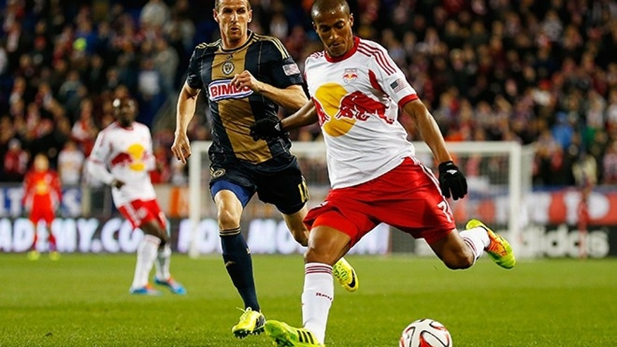 HARRISON, NJ - APRIL 16:  Roy Miller #7 of New York Red Bulls carries the ball in front of Sebastien Le Toux #11 of Philadelphia Union at Red Bull Arena on April 16, 2014 in Harrison, New Jersey. Red Bulls defeated the Union 2-1.  (Photo by Mike Stobe/Getty Images)