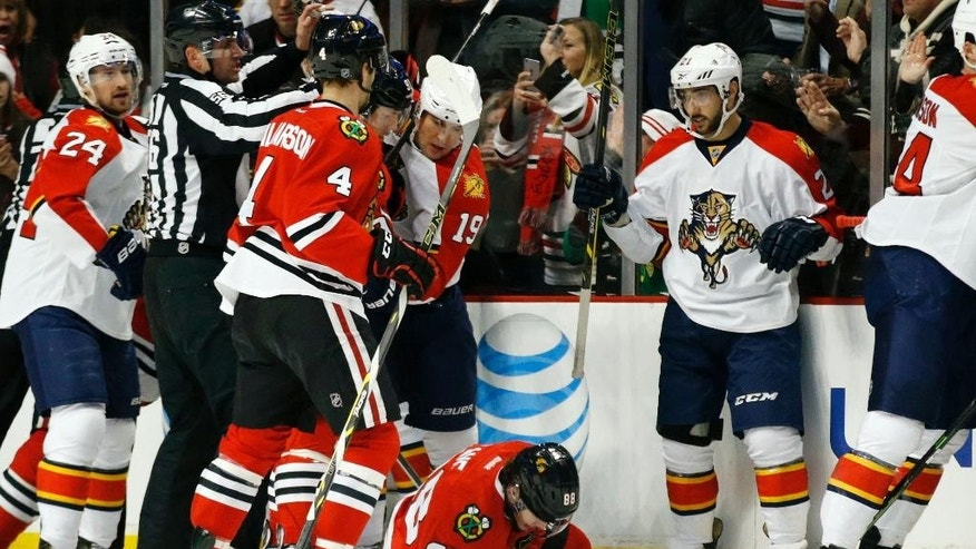 Chicago Blackhawks right wing Patrick Kane (88) picks himself up off the ice after sustaining an injury during the first period of an NHL hockey game against the Florida Panthers on Tuesday, Feb. 24, 2015, in Chicago. (AP Photo/Andrew A. Nelles)
