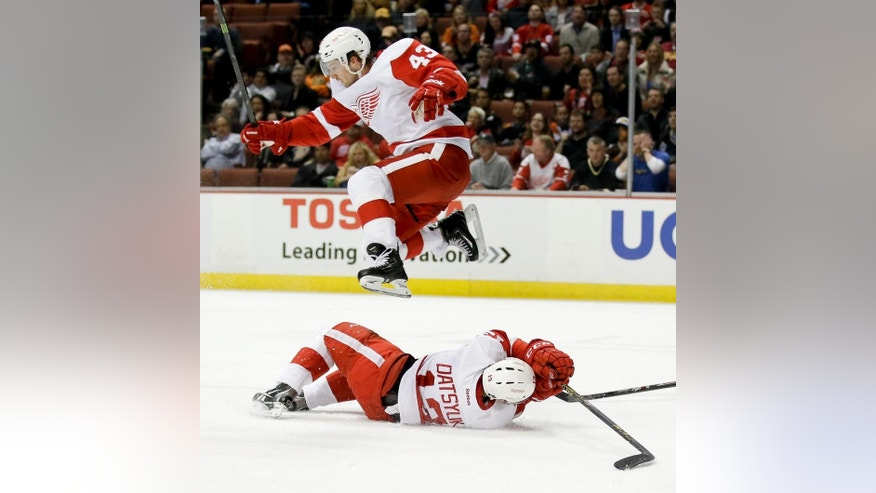 Detroit Red Wings center Darren Helm, top, leaps over center Pavel Datsyuk during the first period of an NHL hockey game against the Anaheim Ducks in Anaheim, Calif., Monday, Feb. 23, 2015. (AP Photo/Chris Carlson)