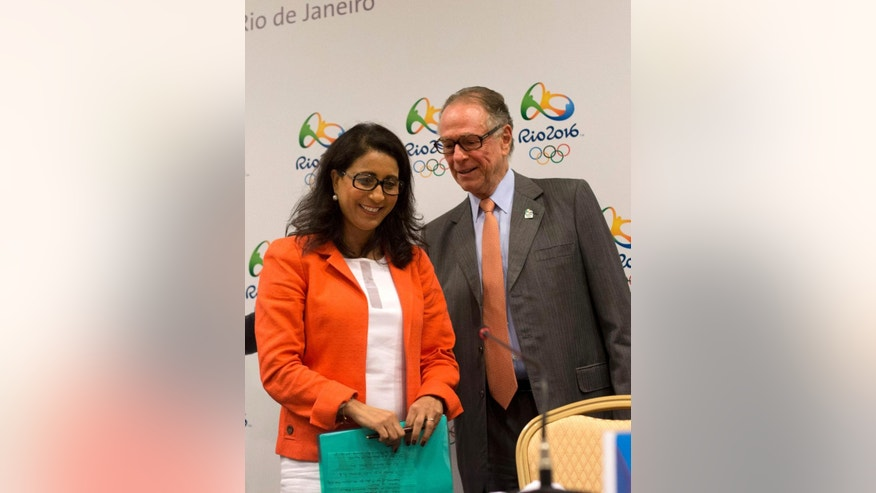 Nawal El Moutawakel, head of the International Olympic Committee's evaluation commission, left, and Brazil's Olympic Committee President Carlos Arthur Nuzman leave a press conference in Rio de Janeiro, Brazil, Wednesday, Feb. 25, 2015. IOC inspectors are visiting the Olympic city to check on preparations for the Olympics, just 18 months away. (AP Photo/Silvia Izquierdo)