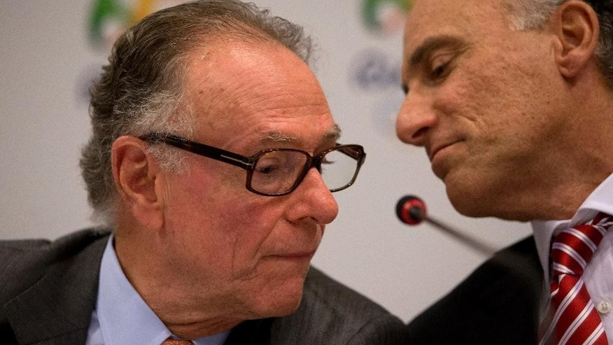 Brazil's Olympic Committee President Carlos Arthur Nuzman, left, talks with Rio 2016 Committee Chief Executive Officer Sidney Levy during a press conference in Rio de Janeiro, Brazil, Wednesday, Feb. 25, 2015. IOC inspectors are visiting the Olympic city to check on preparations for the Olympics, just 18 months away. (AP Photo/Silvia Izquierdo)