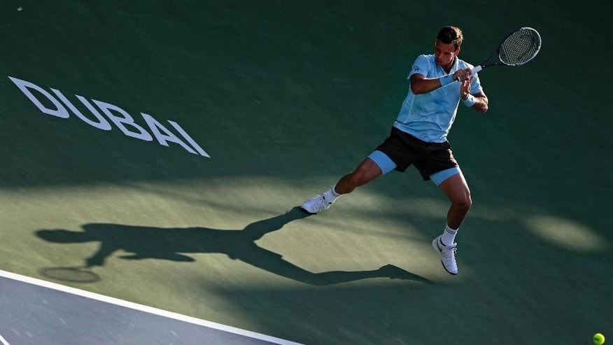 Tomas Berdych of the Czech Republic returns the ball to Simone Bolelli of Italy during the Dubai Duty Free Tennis Championships in Dubai, United Arab Emirates, Wednesday, Feb. 25, 2015. (AP Photo/Kamran Jebreili)