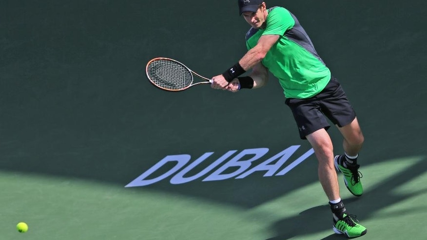 Andy Murray of Great Britain returns the ball to Joao Sousa of Spain during the Dubai Duty Free Tennis Championships in Dubai, United Arab Emirates, Wednesday, Feb. 25, 2015. (AP Photo/Kamran Jebreili)