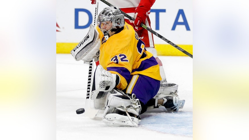 Los Angeles Kings goalie Jonathan Quick makes a save against the Detroit Red Wings during the first period of an NHL hockey game in Los Angeles, Tuesday, Feb. 24, 2015. (AP Photo/Chris Carlson)
