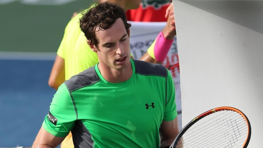 Andy Murray of the Great Britain reacts after he lost a match against Borna Coric of Croatia during a quarter final of the Dubai Duty Free Tennis Championships in Dubai, United Arab Emirates, Thursday, Feb. 26, 2015. (AP Photo/Kamran Jebreili)
