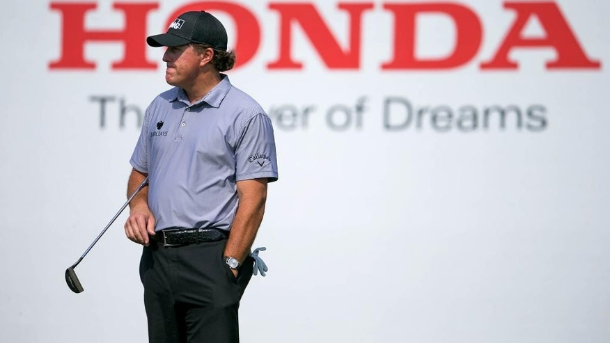 Phil Mickelson stands during during the Honda Classic Gold Pro-Am in Palm Beach Gardens, Fla., Wednesday, Feb. 25, 2015. (AP Photo/The Palm Beach Post, Allen Eyestone)