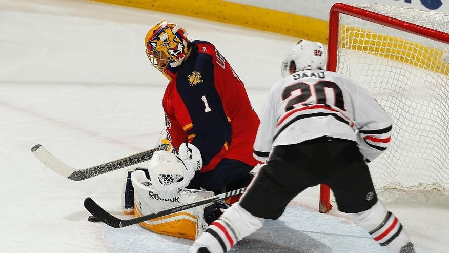 Chicago Blackhawks forward Brandon Saad (20) is unable to reach the rebound given up by Florida Panthers goaltender Roberto Luongo (1) during the third period of an NHL hockey game, Thursday, Feb. 26, 2015, in Sunrise, Fla. The Blackhawks defeated the Panthers 3-0. (AP Photo/Joel Auerbach)