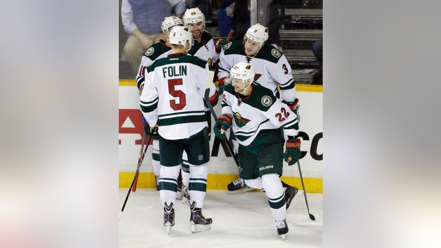 Minnesota Wild right wing Nino Niederreiter (22), of Switzerland, celebrates after scoring a goal against the Nashville Predators in the second period of an NHL hockey game Thursday, Feb. 26, 2015, in Nashville, Tenn. (AP Photo/Mark Humphrey)