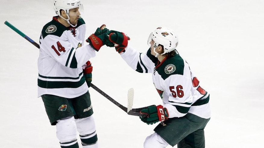 Minnesota Wild left wing Erik Haula (56), of Finland, celebrates with Justin Fontaine (14) after Haula scored a goal against the Nashville Predators in the first period of an NHL hockey game Thursday, Feb. 26, 2015, in Nashville, Tenn. (AP Photo/Mark Humphrey)