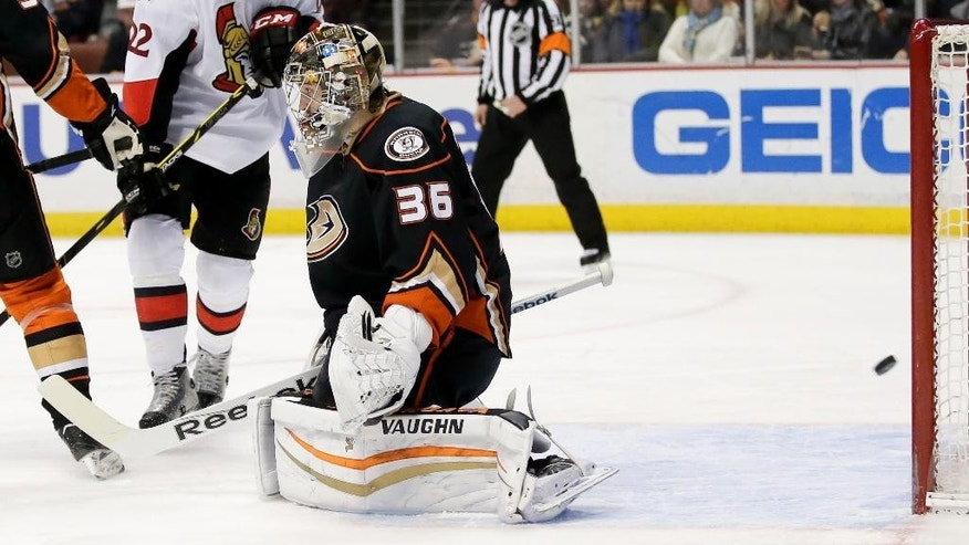 Ottawa Senators right wing Erik Condra, left, scores past Anaheim Ducks goalie John Gibson during the first period of an NHL hockey game in Anaheim, Calif., Wednesday, Feb. 25, 2015. (AP Photo/Chris Carlson)