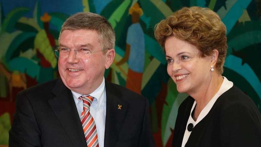 Brazil's President Dilma Rousseff, right, shakes hands with International Olympic Committee President Thomas Bach at the Planalto presidential palace in Brasilia, Brazil, Tuesday, Feb. 24, 2015. The IOC's coordination commission is visiting venues and meeting with local organizers as Rio races to be ready on time for South America's first games, set for 2016. (AP Photo/Eraldo Peres)