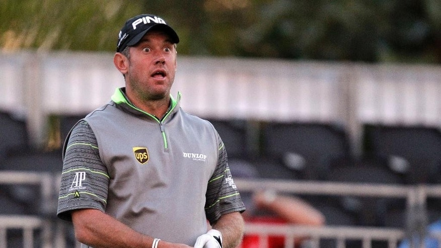 Lee Westwood, of England, reacts after teeing off during the first round of the Honda Classic golf tournament, Thursday, Feb. 26, 2015 in Palm Beach Gardens, Fla. (AP Photo/Luis M. Alvarez)
