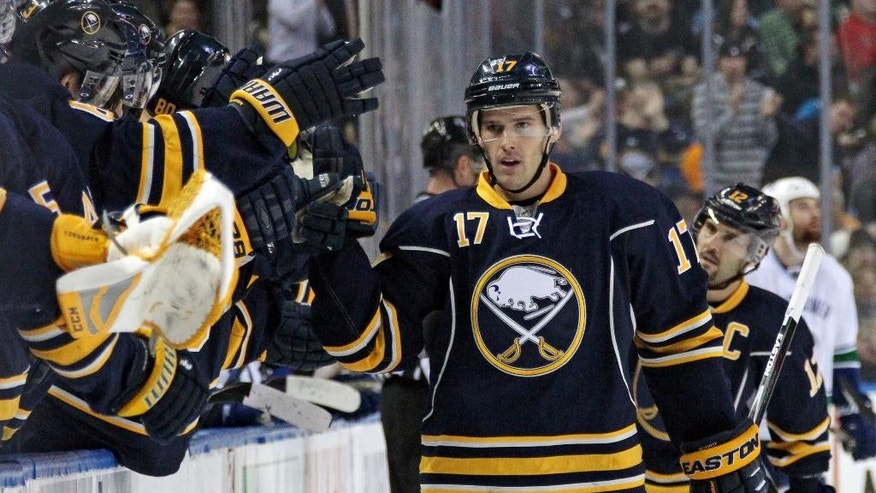 Buffalo Sabres' Torrey Mitchell (17) celebrates his goal against the Vancouver Canucks with teammates along the bench during the first period of an NHL hockey game Thursday, Feb. 26, 2015, in Buffalo, N.Y. (AP Photo/Jen Fuller)