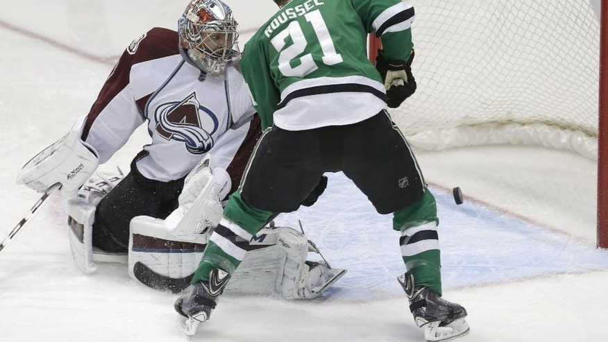 Dallas Stars left wing Antoine Roussel (21) looks on as the puck slips past Colorado Avalanche goalie Semyon Varlamov (1) for a goal during the second period of an NHL hockey game Friday, Feb. 27, 2015, in Dallas. Stars center Cody Eakin scored the goal. (AP Photo/LM Otero)