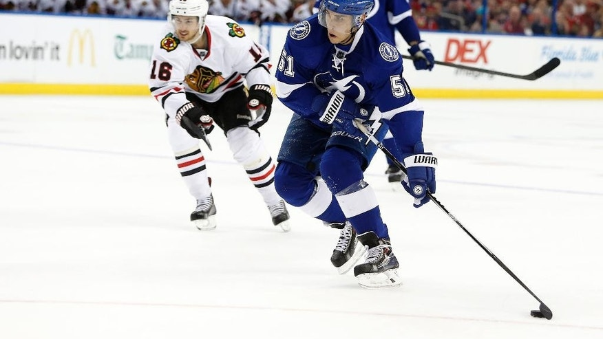 Tampa Bay Lightning center Valtteri Filppula (51), of Finland, controls the puck against Chicago Blackhawks center Marcus Kruger (16), of Sweden, during the second period of an NHL hockey game Friday, Feb. 27, 2015, in Tampa, Fla. (AP Photo/Brian Blanco)