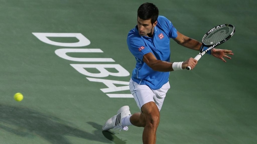 Novak Djokovic of Serbia returns the ball to Tomas Berdych of the Czech Republic during a semi final match of the Dubai Duty Free Tennis Championships in Dubai, United Arab Emirates, Friday, Feb. 27, 2015. (AP Photo/Kamran Jebreili)