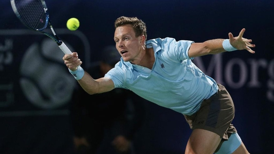 Tomas Berdych of the Czech Republic returns the ball to Novak Djokovic of Serbia during a semi final match of the Dubai Duty Free Tennis Championships in Dubai, United Arab Emirates, Friday, Feb. 27, 2015. (AP Photo/Kamran Jebreili)